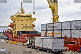 demo-attachment-23-loading-cargo-into-the-ship-in-harbor-PF86726